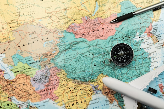 Magnetic compass and stationary on map. Premium Photo