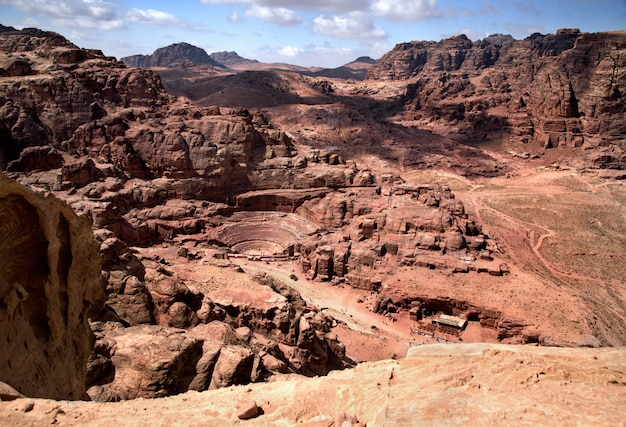Magnificent view of petra, jordan. the amphitheatre cut into the rock and ancient rock caves Premium Photo
