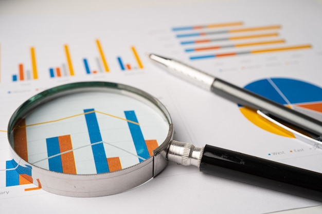 Magnifying glass on graphs paper. Premium Photo