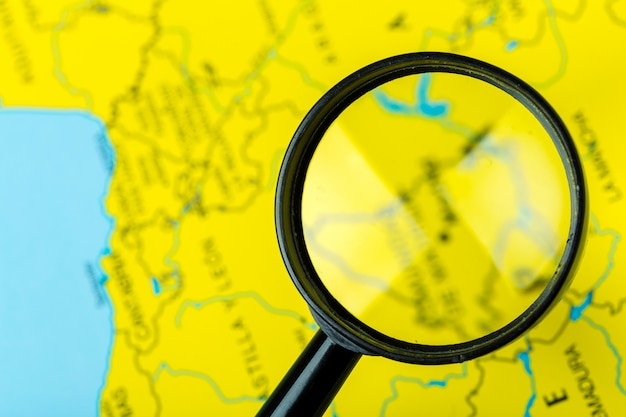 Magnifying glass and map Premium Photo