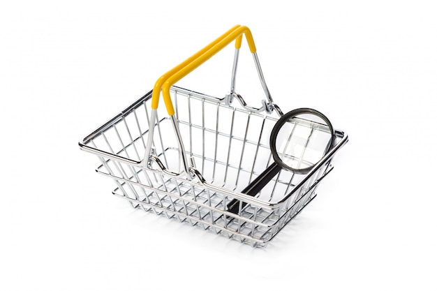 Magnifying glass and shopping cart isolated on white Premium Photo