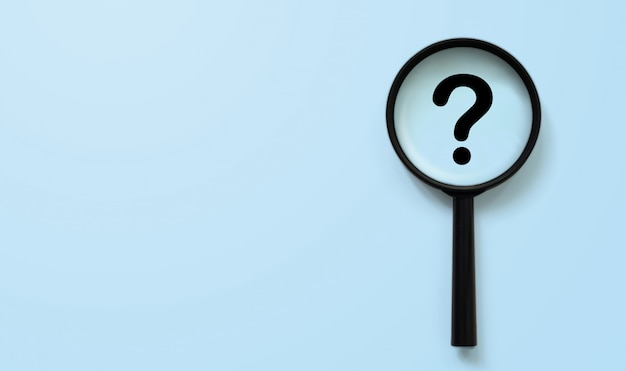 Magnifying glass with question mark symbol Premium Photo
