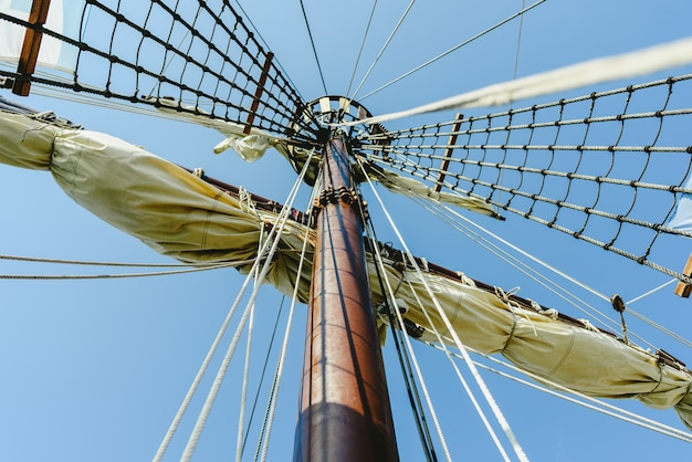 Mainmast and rope ladders to hold the sails of a sailboat. Premium Photo