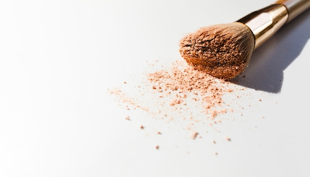 Make up brush on white background Free Photo