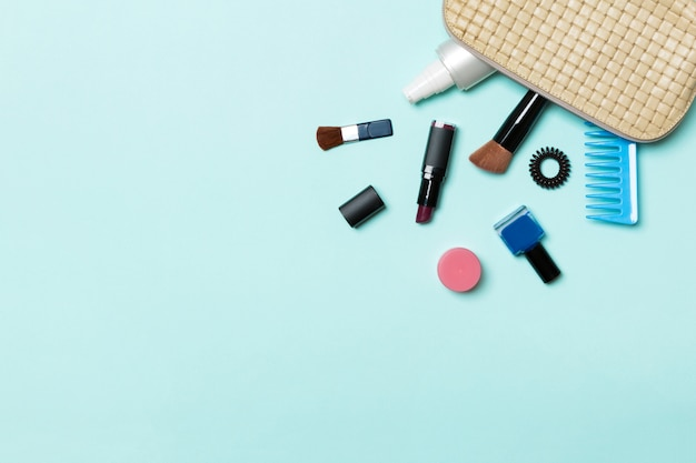 Make up products fallen out of cosmetics bag Premium Photo