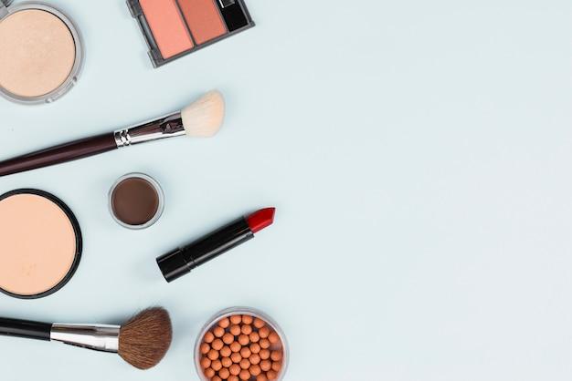 Makeup accessories arrangement on light background Free Photo