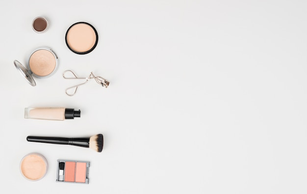 Makeup beauty accessories on white background Free Photo