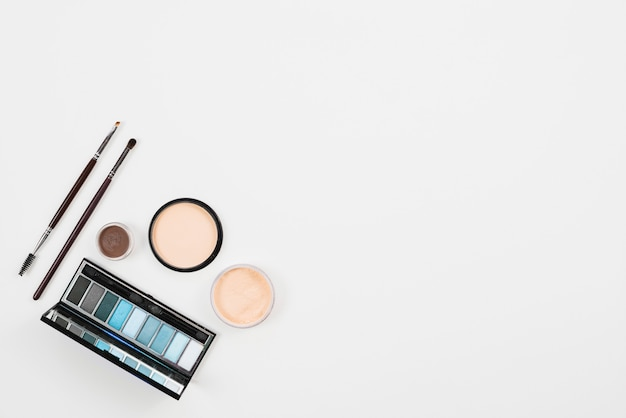 Makeup and beauty product in blue palette on white background Free Photo