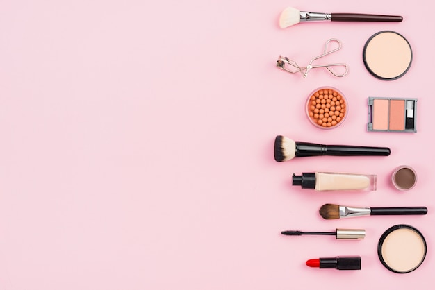 Makeup and cosmetic beauty products on pink background Free Photo