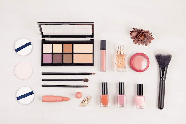 Of makeup cosmetic products, flat lay, top view. Premium Photo