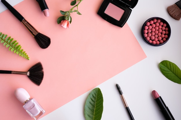 Makeup cosmetic products with nature leaf on pink background. Premium Photo