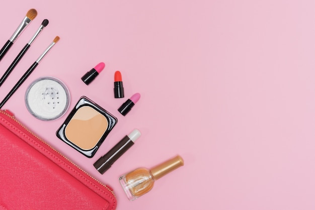 Makeup cosmetics palette and brushes on pink background flat lay Free Photo