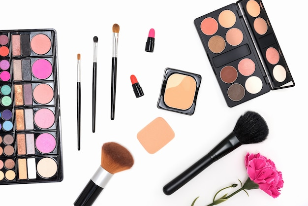 Makeup cosmetics palette and brushes on pink background Free Photo