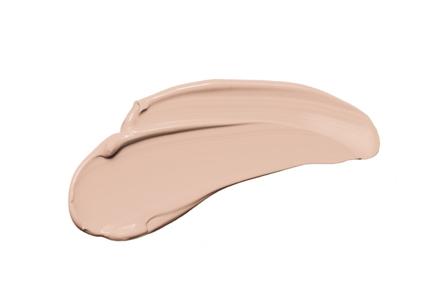 Makeup foundation, beige concealer smudge isolated on white Premium Photo