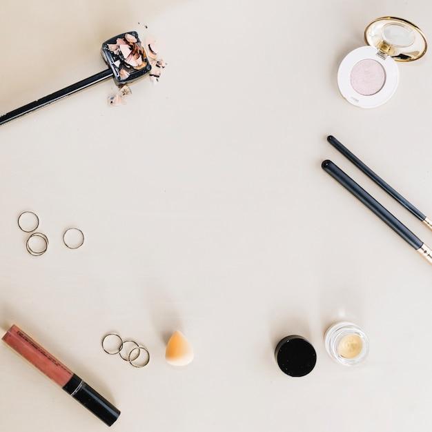 Makeup supplies on white background Free Photo
