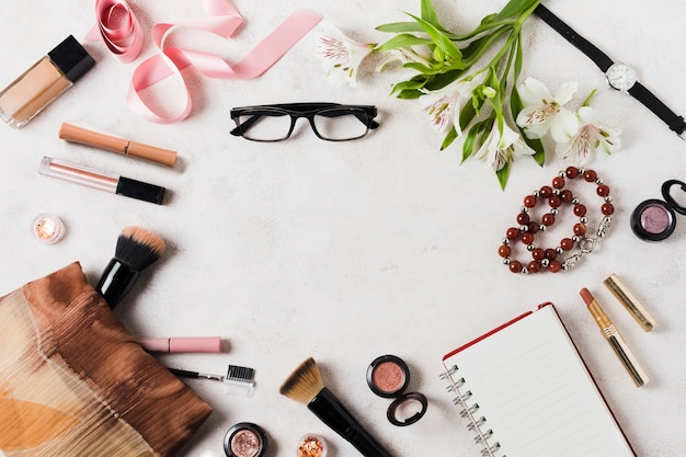 Makeup tools and accessories on light surface Free Photo