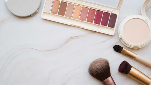 Makeup tools and eyeshadow Free Photo