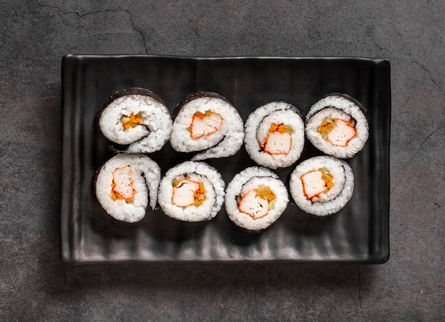 Maki rolls on black slate Free Photo