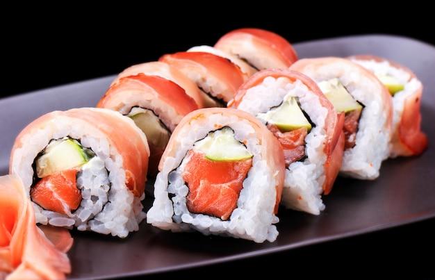 Maki sushi roll with parma ham Premium Photo