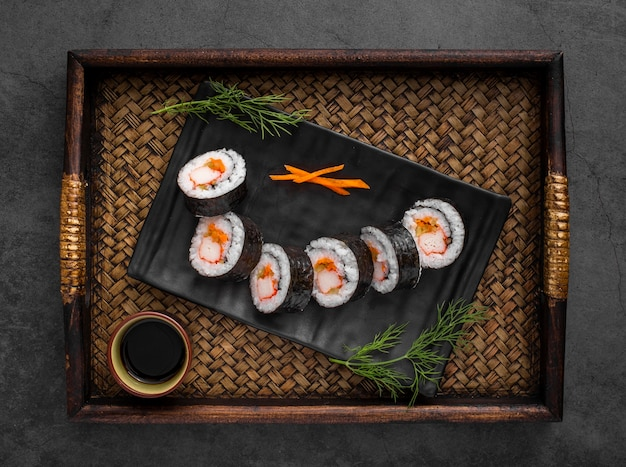 Maki sushi rolls on black slate Free Photo