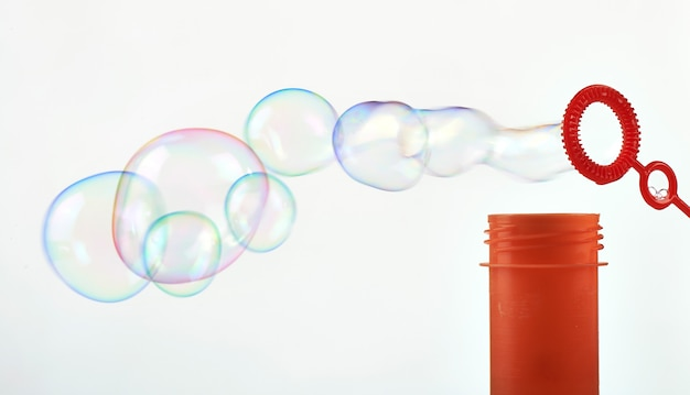 Making abstract soap bubble on white Premium Photo