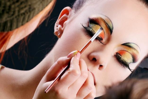 Making beautiful make up Free Photo