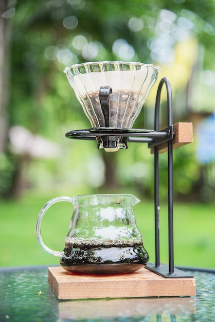 Making drip coffee in vintage coffee shop with green garden nature Free Photo