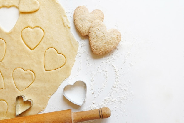 Making homemade heart shaped cookies for valentine day Premium Photo