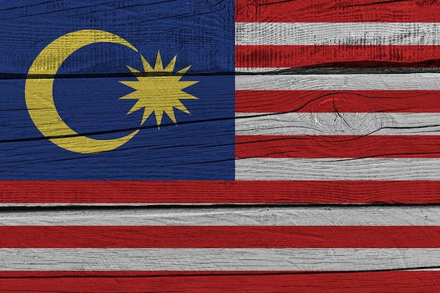 Malaysia flag painted on old wood plank Premium Photo