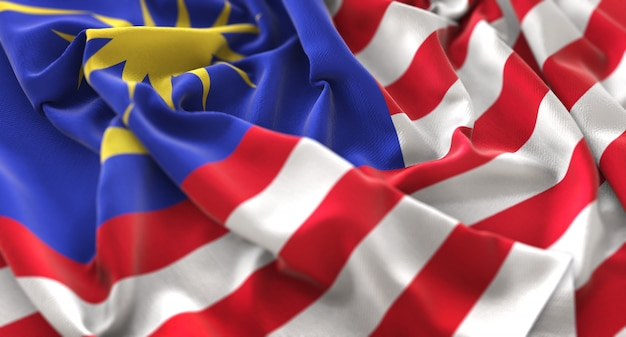 Malaysia flag ruffled beautifully waving macro close-up shot Free Photo