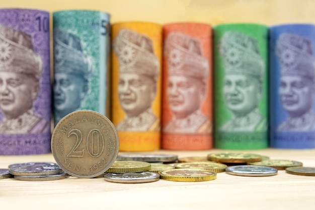 Malaysian ringgit banknotes on wooden table Premium Photo