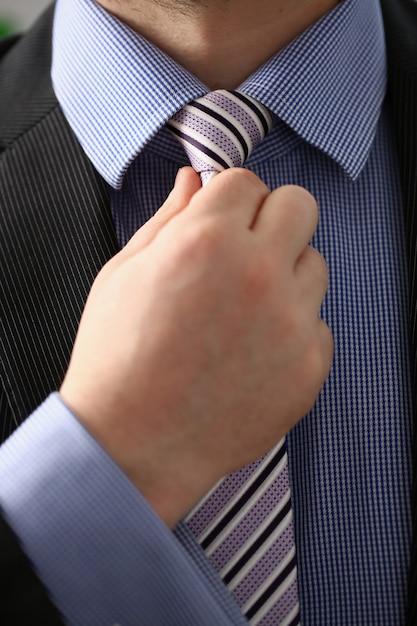 Male arm in brown suit set tie closeup Premium Photo