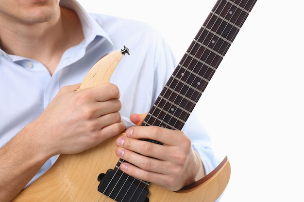 Male arms playing classic shape electric guitar Premium Photo