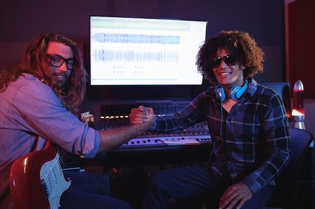 Male audio engineers using digital tablet Free Photo