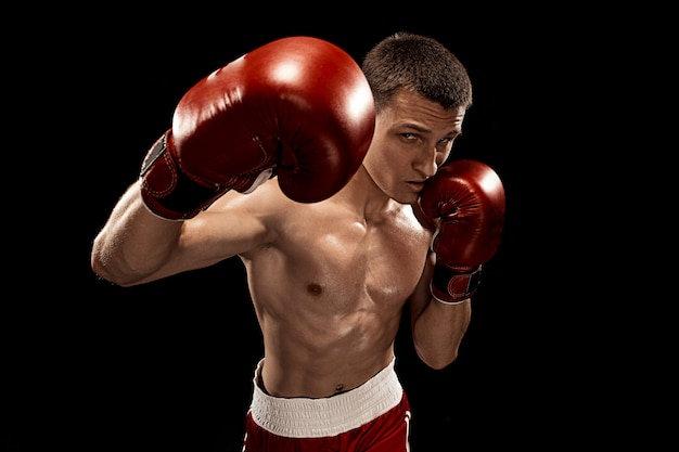 Male boxer boxing on black Free Photo