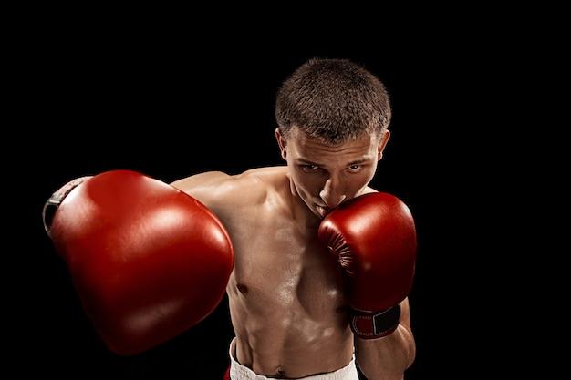 劇的なエッジの効いた照明の男性ボクサーボクシング 無料写真