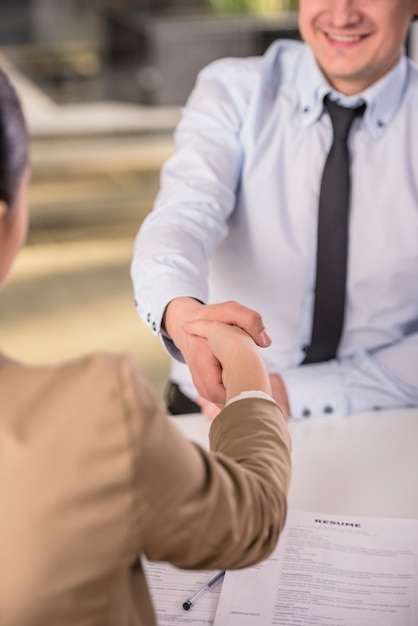 Male candidate shaking hands with businesswoman. Premium Photo