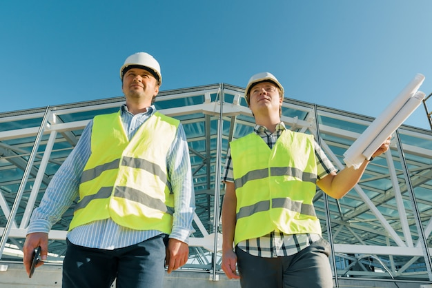 Male construction worker and engineer at the construction site. Premium Photo