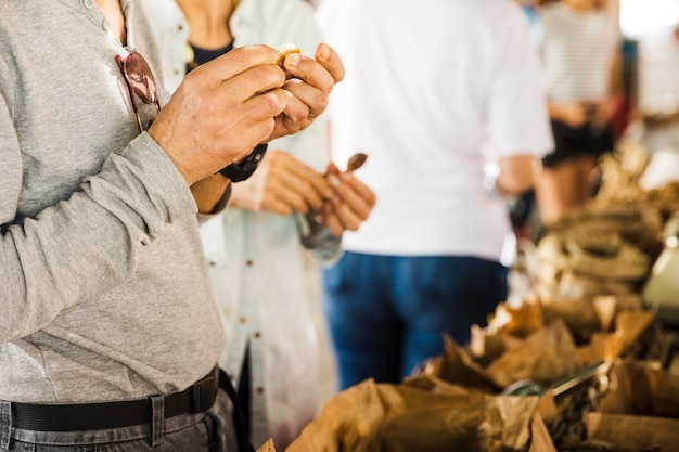 Male consumer choosing date at market stall Free Photo