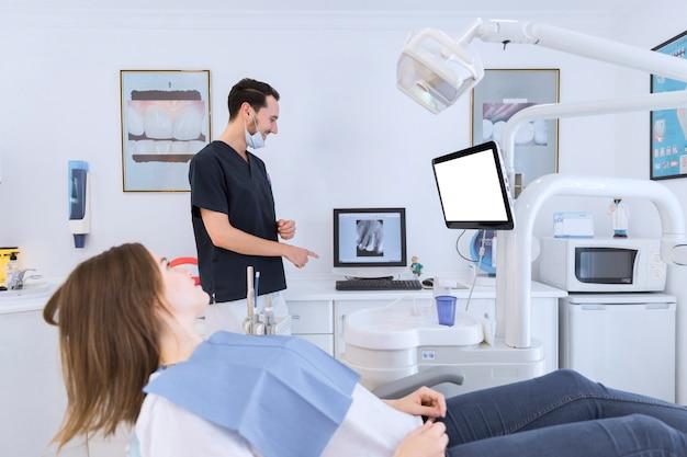 Dentist using a dental imaging software