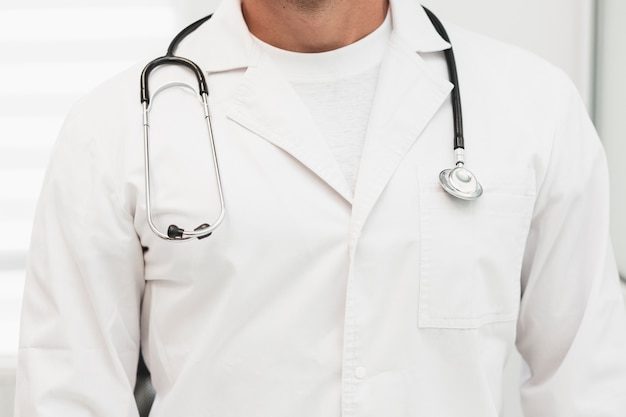 Male doctor robe with stethoscope on shoulders Free Photo