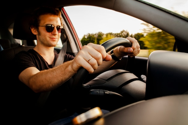Male driving car on road Free Photo