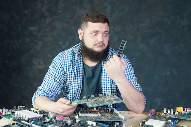 Male engineer work with broken computer components. electronic devices repairing technology Premium Photo