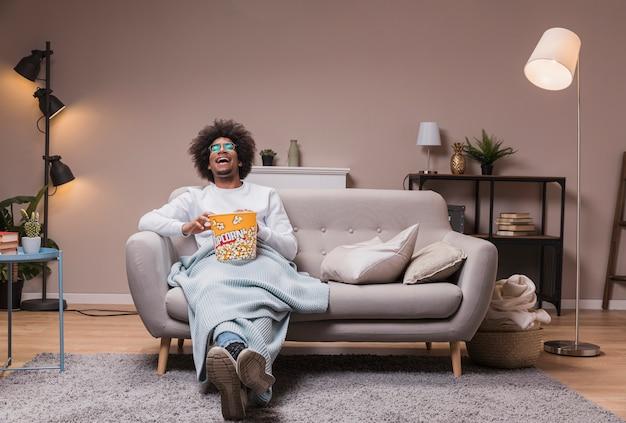 Male enjoying movie and popcorn Free Photo