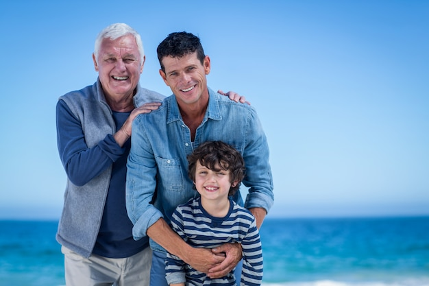 Male family members posing at the beach Premium Photo