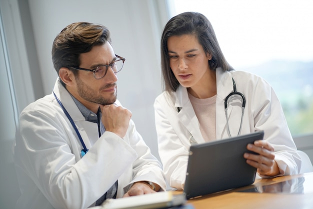 Male and female doctors going through patient's results Premium Photo