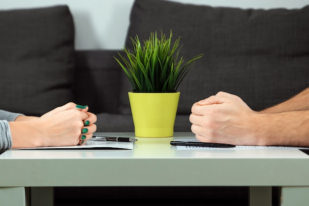 Male and female hands are folded opposite each other Premium Photo