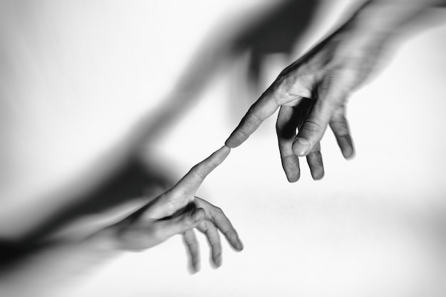 Male and female hands connected with each other together and forever. toned. Premium Photo