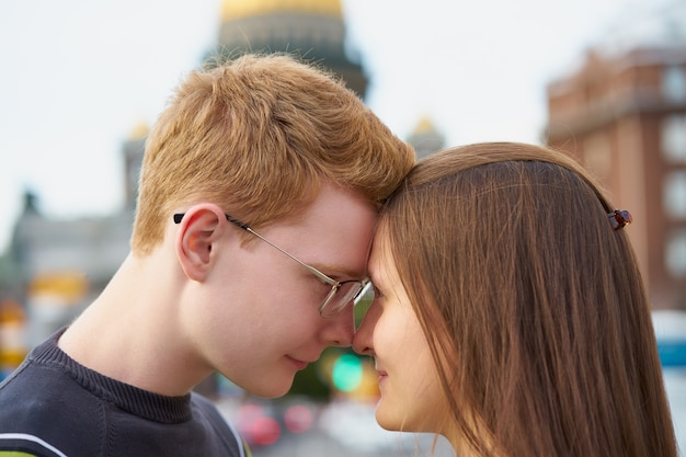 Male and female person looking at each other, young couple full of love Premium Photo