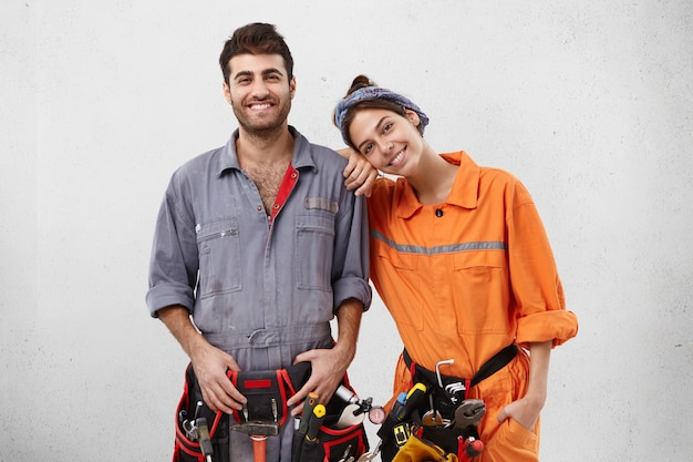 Male and female workers wearing work clothes Free Photo